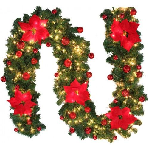 Ghirlanda di Natale per camini con luci e decorazioni rosse