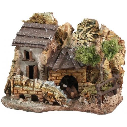 Modellino casa in stucco con rimessa legna, realizzato a mano